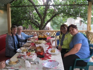 Food and fellowship, on the left two nuns from Ireland doing mission work in Bucharest.